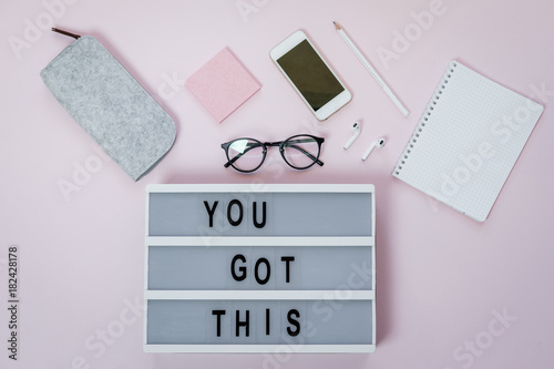 Photo Motivational board, phone and stationery on pink table