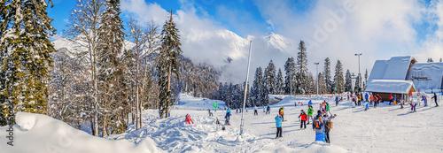 Photo  KRASNAYA POLYANA, SOCHI, RUSSIA - JANUARY 31, 2016: Panorama of the skiing run and top elevator Shelter Fir