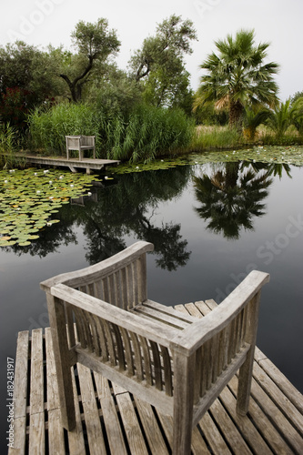 Chairs at a water lily pond, Algarve, Portugal