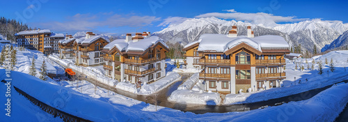 KRASNAYA POLYANA, SOCHI, RUSSIA - JANUARY 31, 2016: Snow-covered cottages Polyana 1389 hotel SPA Canvas Print