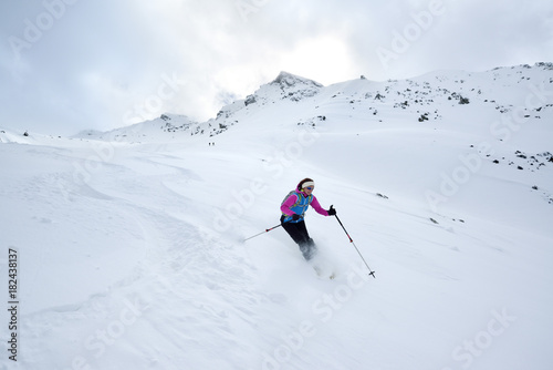 Female back-country skier downhill skiing from Piz Laschadurella, Sesvenna Alps, Engadin, Graubuenden, Switzerland
