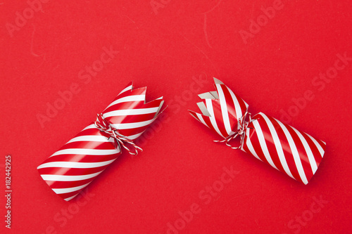 Christmas crackers on a red background Wallpaper Mural