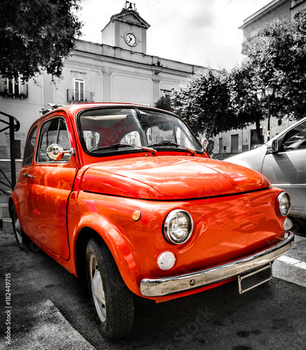 Deurstickers Oude auto s vintage red italian car old selective color black and white italy town 500