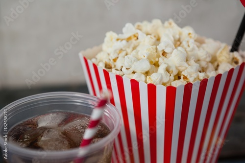 Close-up of popcorn and cold drink