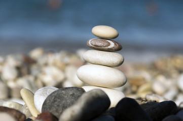 Fototapeta na wymiar Stones and pebbles stack, harmony and balance, one stone cairn on seacoast