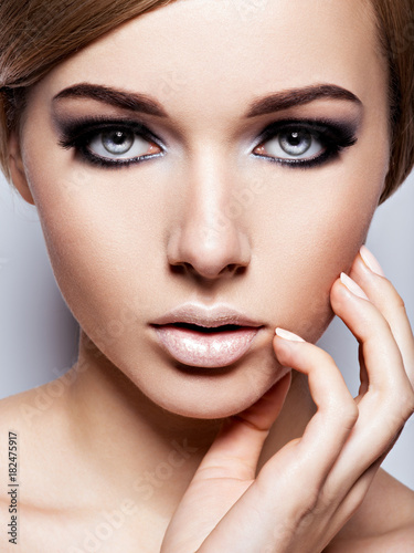 Plagát  Beautiful woman with fashion makeup of eyes
