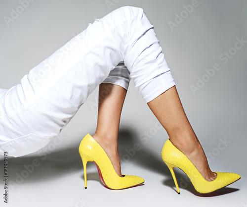 Part of women legs in beautiful fashionable high heels Canvas-taulu