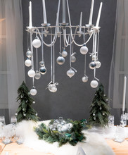 Vintage Hanging Candle Chandelier Decorated With Silver And White Ornaments Above Christmas Dining Table