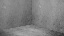Empty Corner Room With Grey Concrete Wall And Floor Background,Mock Up Studio Room For Display Or Montage Of Product For Advertising On Media,Business Presentation