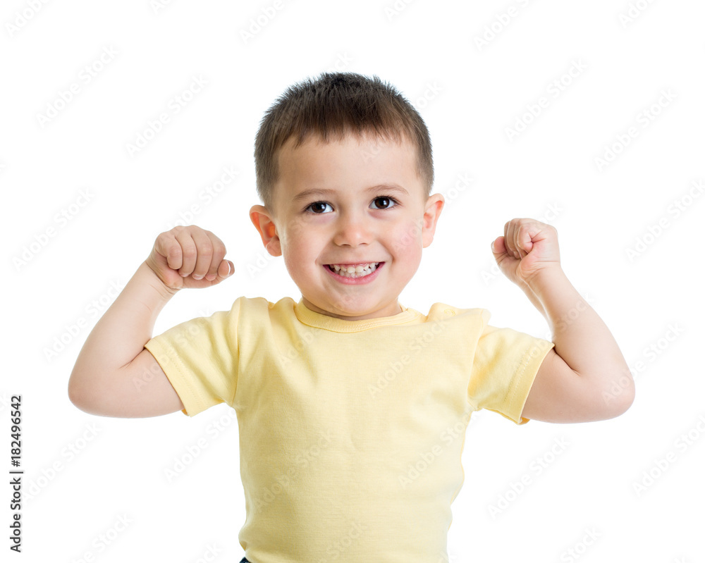 Fototapeta Portrait of cute kid showing the muscles of his arms, isolated on white