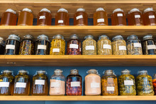 Rows Of Preserved Food In Glass Jars On Wooded Shelves