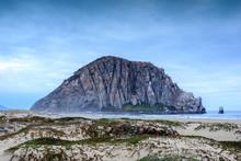 Morro Rock With Sandy Dunes Of Morro Creek Beach. Morro Bay, San Luis Obispo County, California, USA.