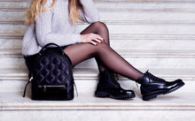 Woman Legs In Black Ankle Boot...