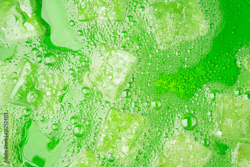 Green soda water juice cold drink fruit with ice and bubble for background design hi resolution detail texture surface