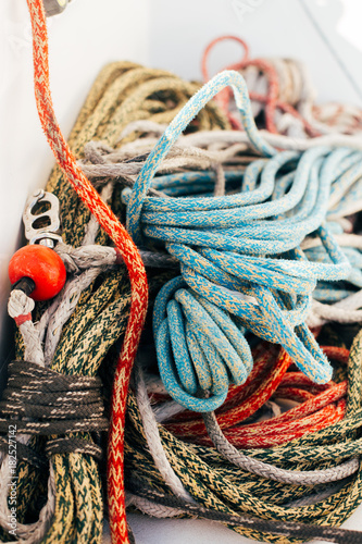 Running and rigging of nautical marine ropes pile on yacht or