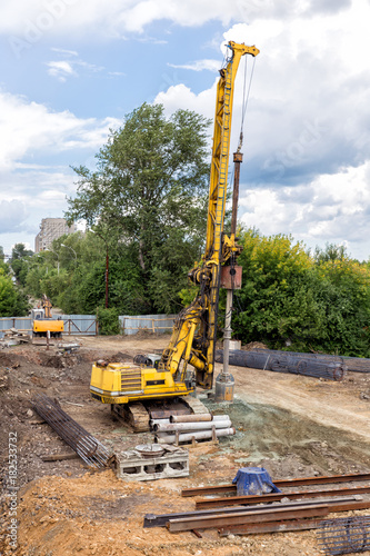 Piling machine  Construction site - Buy this stock photo and