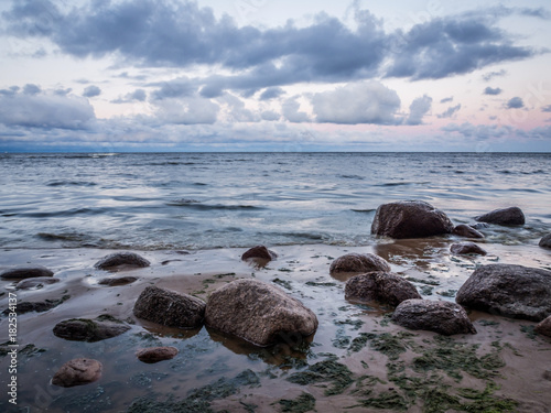 Seascape With Rocks Lying On Sea Coast In The Morning