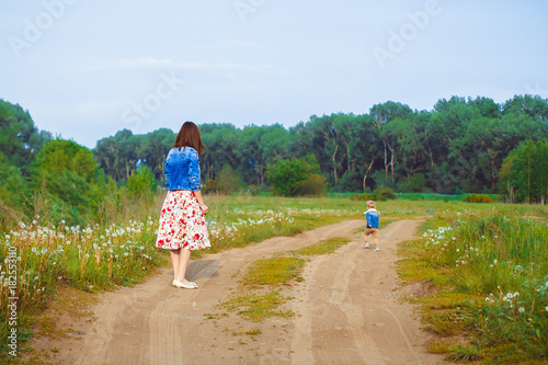 Fotografia, Obraz  mother and son walking on country road