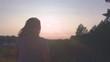 the setting sun in the girl's