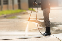 High Pressure Deep Cleaning.Worker Cleaning Driveway With Gasoline High Pressure Washer ,professional Cleaning Services.