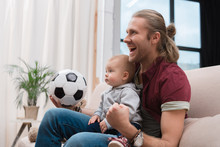 Excited Father With Baby Boy W...