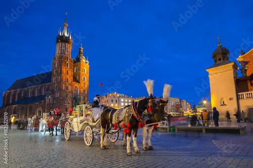Fototapeta Horse carriages at the Main Square in Krakow, Poland obraz