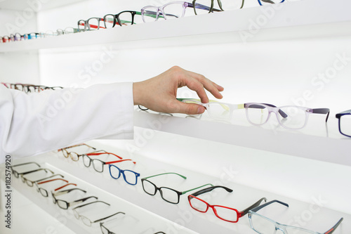 oculist selects a frame for glasses to correction of vision, at the ...