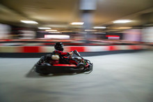 Cart (kart) Blurred By High Speed, A Boy Having Fun - Driving Fast, Racing, Speeding.