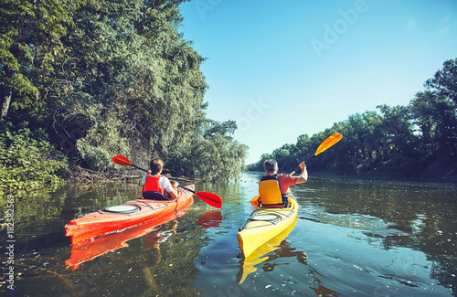 A canoe trip on the river in the summer. Wallpaper Mural