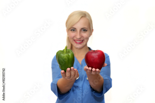 portrait of female doctor in blue dressing gown with two apples ...