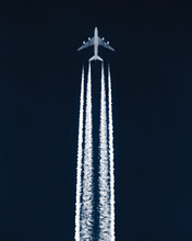 Airplane In The Sky Leaving Co...
