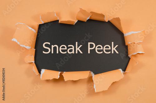 Valokuva  The phrase Sneak Peek appearing behind torn paper.