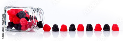 Cadres-photo bureau Confiserie colorful candies in glass jars on white background - Web banner with food concept