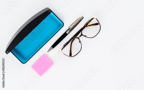 eyeglasses with case fancy pen and sticky note paper flatlay buy