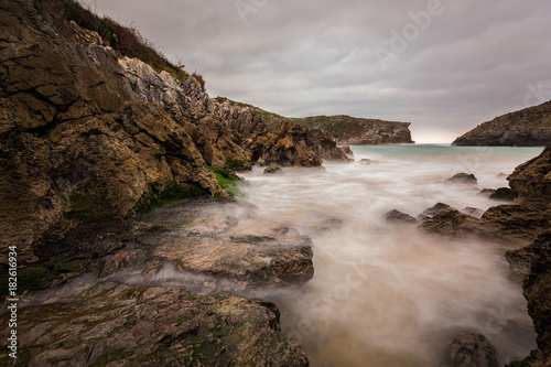 Landscape with long exposure on the coast of Cue Poster