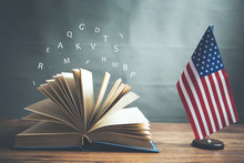 Opening Book And American Flag