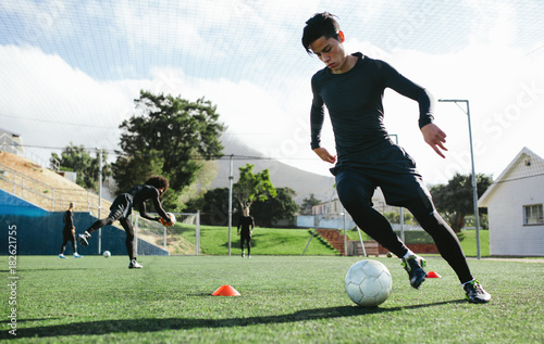 Soccer player practicing ball control