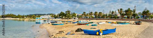 Photo Stands Tunisia Wooden boats on the Mediterranean coast in Hammamet, Tunisia