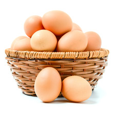 Eggs In Basket Isolated On Whi...