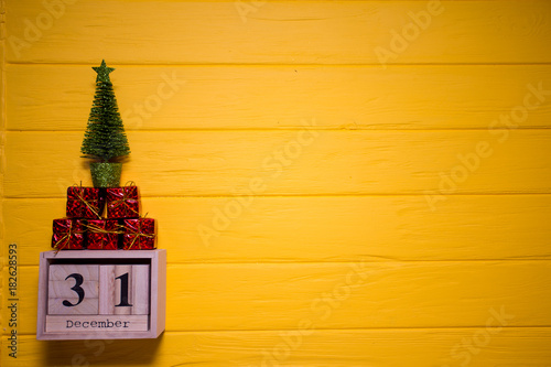 december 31st day 31 of december set on wooden calendar on yellow wooden plank background
