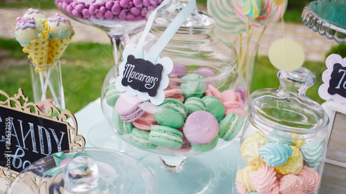 Details of a tasty candy bar with jugs of sweets, cookies and marshmallows, Candy, waffles, cookies and macaroons , sweets concept on Children's birthday