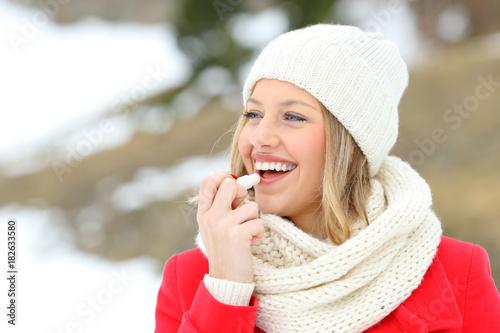 Fotografie, Obraz  Girl protecting lips with lip balm in winter
