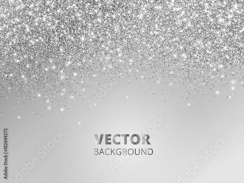 Fototapeta Falling glitter confetti. Vector silver dust, explosion on grey background. Sparkling glitter border, festive frame. obraz