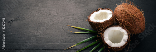 Obraz na plátně Coconut on a wooden background