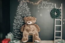 Christmas Background In Black With A Painted Christmas Tree, Ladder, Teddy Bear And Wreath