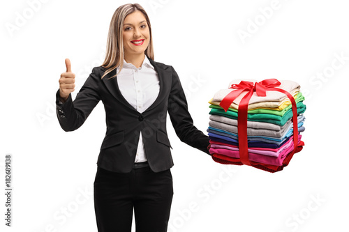 Formally Dressed Woman With A Stack Of Clothes Wrapped With Red