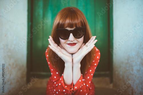 Charming model in sunglasses posing at camera