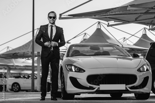 Successful yang businessman in yellow cabrio car. Poster