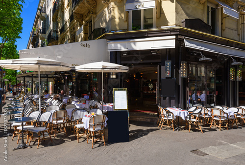 Typical view of the Parisian boulevard with tables of brasserie (cafe) in Paris, Canvas Print