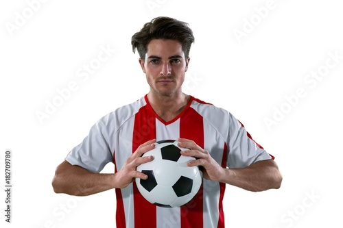Football player holding football with both hands Fototapet